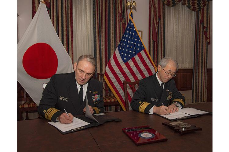 WASHINGTON (Feb. 5, 2020) Vice Adm. Rick Williamson, deputy chief of naval operations for fleet readiness and logistics, and Japan Maritime Self-Defense Force Rear Adm. Masatomi Dairiki, director general of logistics department, Maritime Support Office, sign an agreement to improve interoperability for maritime logistics between the U.S. Navy and the Japan Maritime Self-Defense Force during a formal ceremony at the Pentagon. (U.S. Navy photo by Mass Communication Specialist 2nd Class Ford Williams/Released)