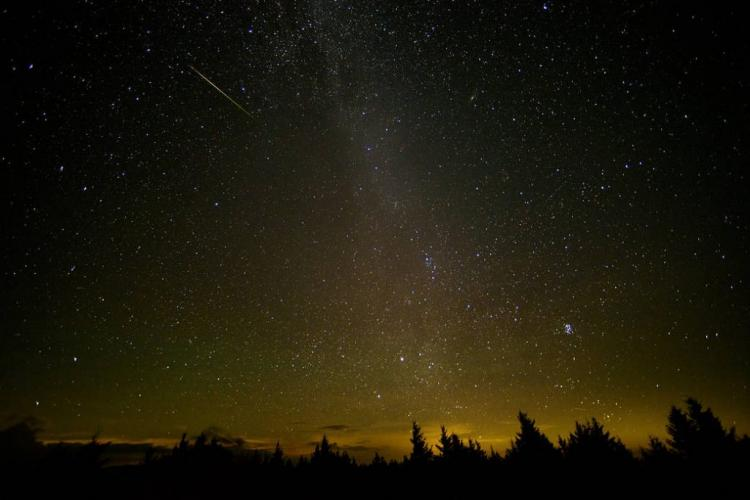 In this 30 second exposure, a meteor streaks across the sky during the annual Perseid meteor shower Friday, Aug. 12, 2016 in Spruce Knob, West Virginia. The Perseids show up every year in August when Earth ventures through trails of debris left behind by an ancient comet. Image Credit: NASA/Bill Ingalls