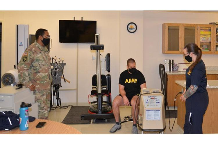 Army Staff Sgt. William Cox, an instructor in the occupational therapy assistant program at the Medical and Education Training Campus at Joint Base San Antonio-Fort Sam Houston, observes a student practicing convective thermal therapy (Photo by: London Prince / Medical and Education Training Campus Protocol Assistant, Joint Base San Antonio-Fort Sam Houston).