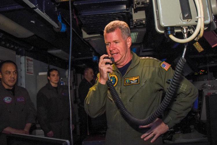 Adm. Samuel Paparo, commander, U.S. Pacific Fleet, addresses the crew of the U.S. Navy's forward-deployed aircraft carrier, USS Ronald Reagan (CVN 76), from the combat direction center.
