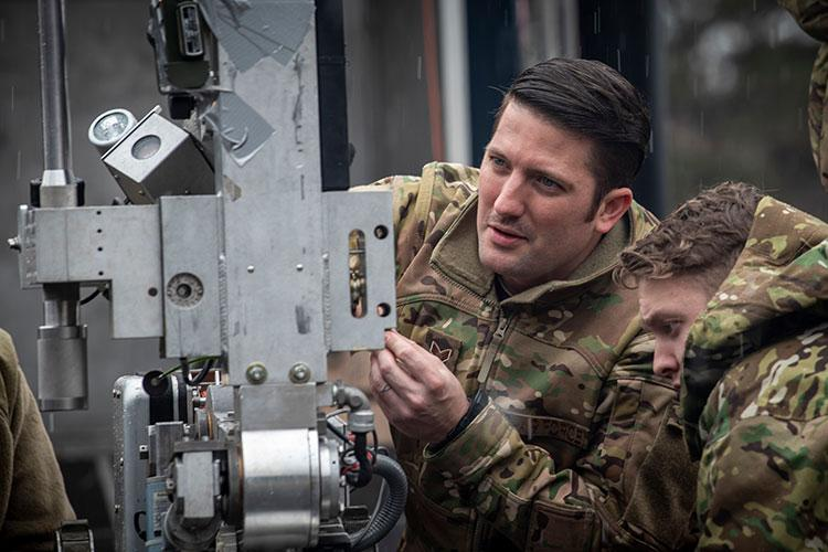 U.S. Air Force Senior Airman Tyrone Powell, left, a 35th Civil Engineer Squadron Explosive Ordnance Disposal journeyman and Airman 1st Class Derik Rosse, right, a 35th CES EOD apprentice, inspect an F6A robot at Misawa Air Base, Japan, March 3, 2020. Personnel work together with reconnaissance robots to help locate, disarm and remove improvised explosive devices. The robots enter inaccessible areas operated by the EOD team, mitigating the risk of danger during training.