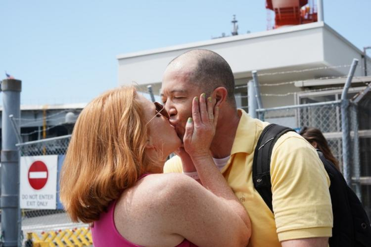Lt. Troy Balding, a catapult officer aboard the USS Ronald Reagan, greets his wife, Chrissy Balding, upon his return after three months at sea to Yokosuka Naval Base, Japan, on Saturday, Aug. 24, 2019. CHRISTIAN LOPEZ/ STARS AND STRIPES