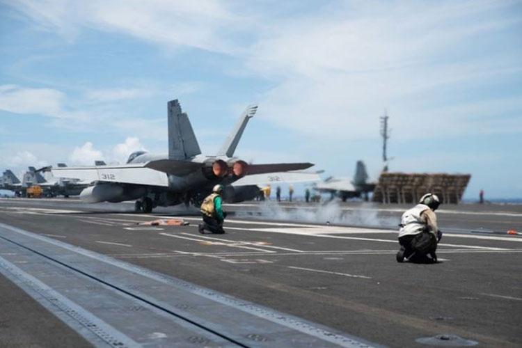 Official U.S. Navy photo of an F/A-18F Super Hornet from the aircraft carrier USS Ronald Reagan (CVN 76) (Photo by Mass Communication Specialist 2nd Class Samantha Jetzer)