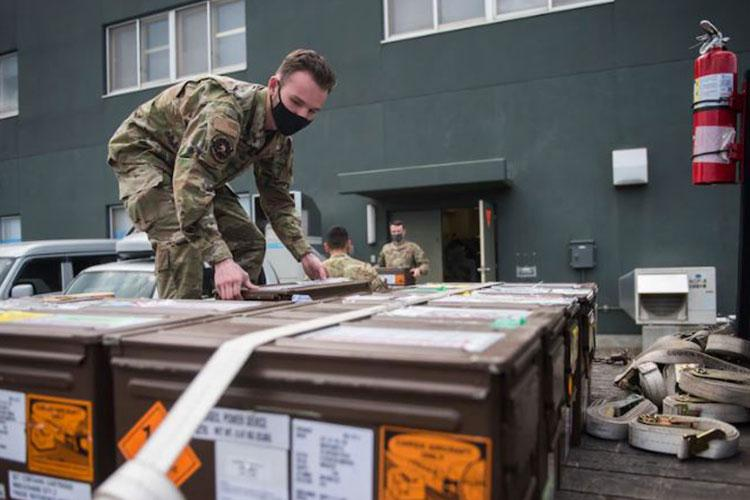 U.S. Air Force Airman 1st Class Abraham Reinwand, a 35th MXS Munitions Flight stockpile management crew chief, lowers Japan Air Self-Defense Force (JASDF) F-35 Lighting II egress system components onto a truck bed at Misawa Air Base, Japan, April 22, 2021. The 35th MXS Munitions Flight is the first team in the Air Force to complete a demilitarization process for a partner-nation's F-35 program. (U.S. Air Force photo by Airman 1st Class Leon Redfern)