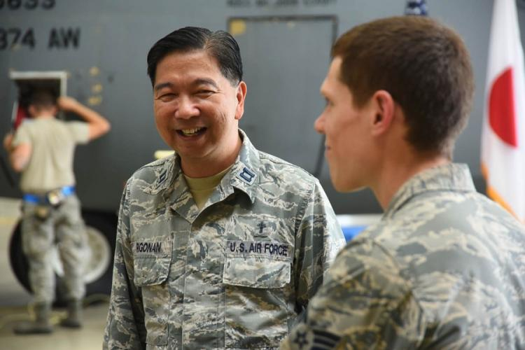 For the past year, Chaplain (Capt.) Antonio Rigonan, left, a Catholic priest from New York, has worked two days a week inside a hangar at Yokota Air Base, Japan. THERON GODBOLD/STARS AND STRIPES