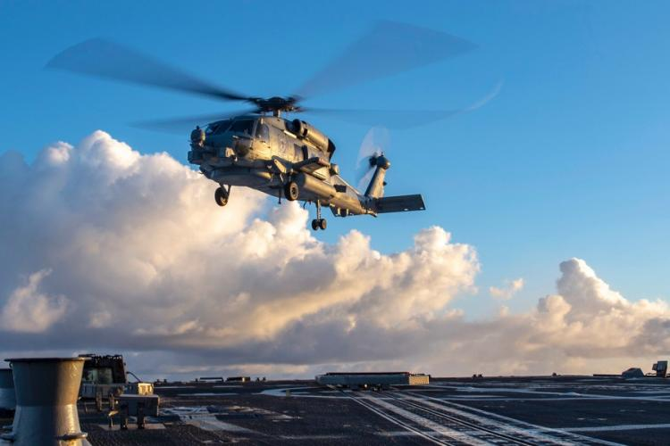 A MH-60 Seahawk helicopter takes off in the Indo-Pacific region. U.S. NAVY