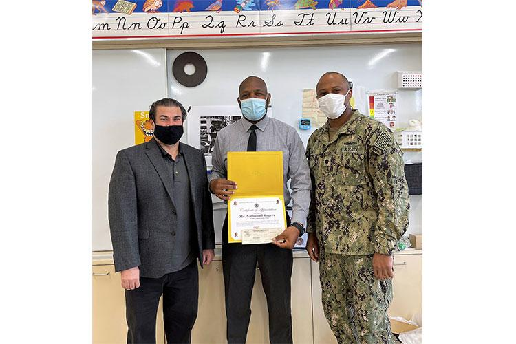Principal of Shirley Lanham Elementary School – Mr. Jesus Calderon with Teacher Appreciation Week Recipient – Mr. Nathaniel Rogers, and Commander Mike Smith, Dental Officer at U.S. Naval Medical Readiness Training Unit, Atsugi, Japan.