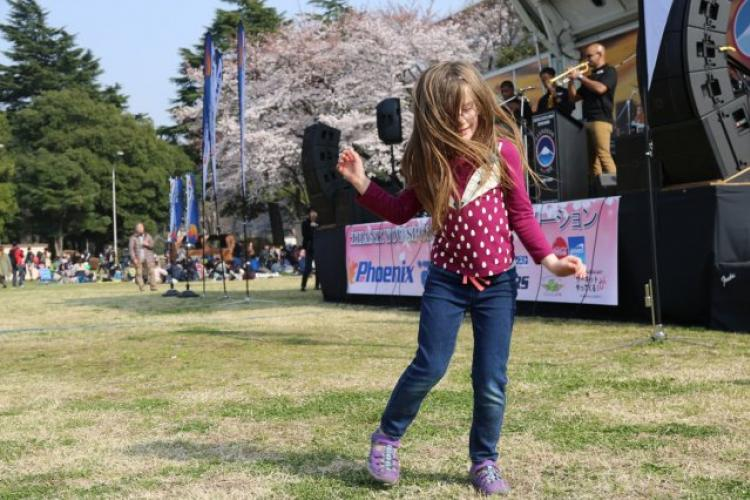 A young attendee at Camp Zama's annual Cherry Blossom Festival dances to live music from the U.S. Army Band March 30 on Camp Zama. (U.S Army photo by Noriko Kudo) (Photo Credit: Noriko Kudo)