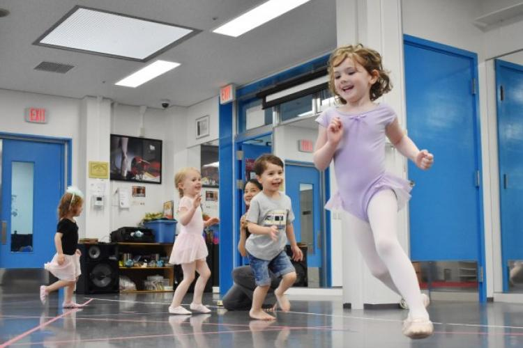 Evelynn Smallwood, 5, leads her classmates in a dance around the room during their pre-K dance class through SKIES Unlimited at Camp Zama's Sagamihara Family Housing Area June 27. (Photo Credit: Wendy Brown, U.S. Army Garrison Japan Public Affairs)