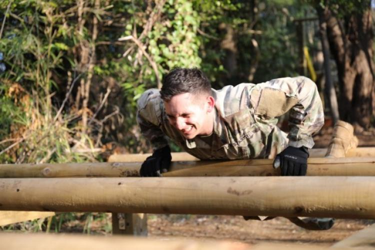 Spc. Benjamin Wright, assigned to U.S. Army Japan's Headquarters and Headquarters Company, maneuvers over an obstacle during physical training his unit conducted on the newly built obstacle course on Camp Zama March 20. (U.S. Army photo by Noriko Kudo)