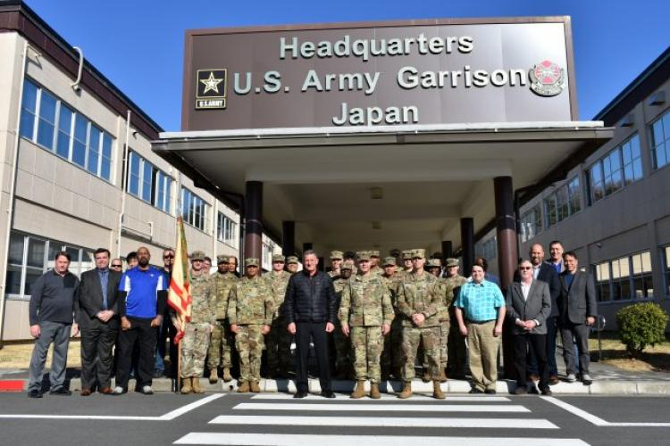 U.S. Army Garrison Japan Soldiers and civilians pose for a photo at garrison headquarters at Camp Zama, Japan, March 8 to commemorate the garrison's command change to U.S. Army Materiel Command. Col. Phillip Gage, commander, USAG Japan, stands center. USAG Japan Command Sgt. Maj. Billy Norman stands to Gage's left, and Steve Niederriter, deputy garrison commander, stands to Gage's right. (Photo Credit: Wendy Brown, U.S. Army Garrison Japan Public Affairs)