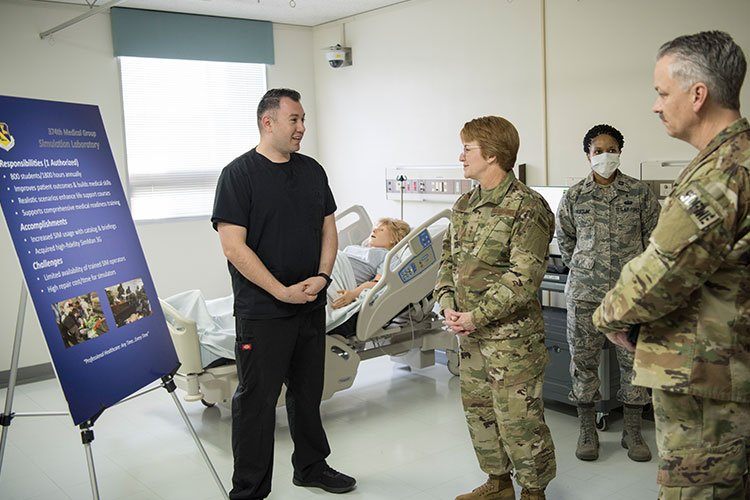 Lt. Gen. Dorothy Hogg, 23rd U.S. Air Force Surgeon General, and, Chief Master Sgt. G. Steve Cum, Chief of the Medical Enlisted Force meet with members of the 374th Medical Group Simulation Laboratory, Jan. 29, 2019, at Yokota Air Base, Japan. More than 700 medical Airmenare deployed in more than 30 nations, supporting warfighters in a variety of ongoing an emergent contingency operations. (U.S. Air Force photo by Senior Airman Kevin West)