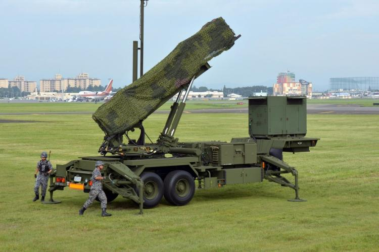 Members of the Japan Air Self-Defense Force set up a Patriot missile-defense battery at Yokota Air Base, Japan, during a demonstration in August 2017. SETH ROBSON/STARS AND STRIPES