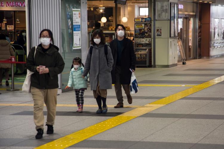 Commuters wear masks inside Haijima Station, near Yokota Air Base, Japan, Wednesday, Feb. 26, 2020. THERON GODBOLD/STARS AND STRIPES