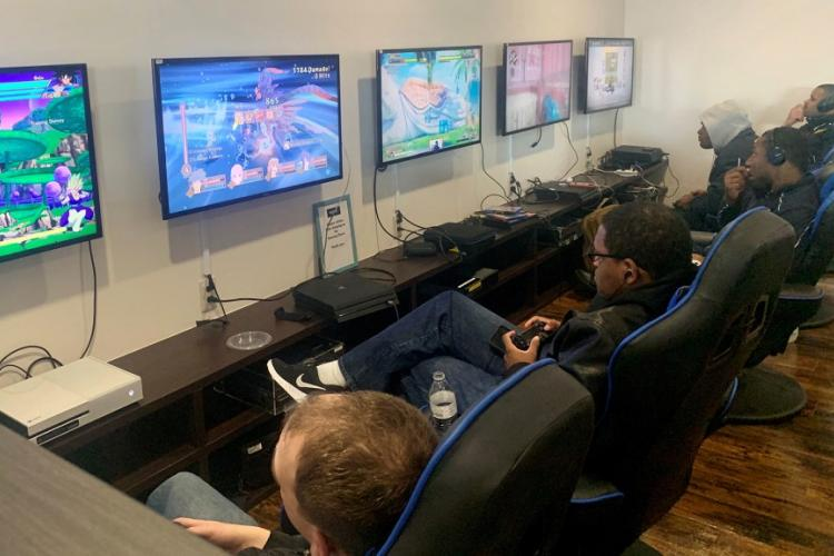 Service members make use of the gaming stations inside the newly renovated USO at Yokosuka Naval Base, Japan, Monday, Feb. 10, 2020. CAITLIN DOORNBOS/STARS AND STRIPES