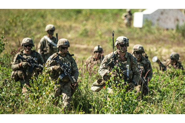 Paratroopers with 1st Battalion, 503rd Parachute Infantry Regiment (Airborne) move from one position to another to provide coverage for their fellow Infantrymen in the Grafenwoehr Training Area this summer. (Photo by Staff Sgt. Jacob Sawyer, 173rd Airborne Brigade.)