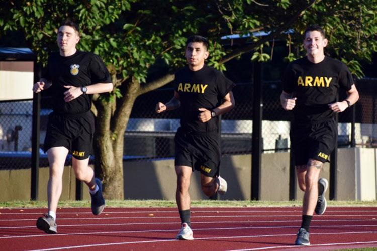 From left, Capt. Dustin Thomas, assigned to Medical Activity Japan, Camp Zama; Spc. Max Ramirez, assigned to the 38th Air Defense Artillery Brigade; and Sgt. Joseph Rudolph, also assigned to MEDDAC-J, train for the Army Ten-Miler at Zama Middle High School, Camp Zama, Japan, Aug. 27. (Photo Credit: Winifred Brown)