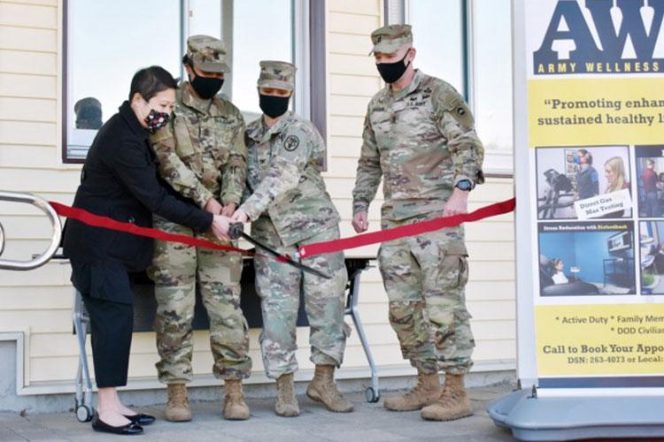 From left, Shannon Vo, director of the Camp Zama Army Wellness Center; U.S. Army Medical Department Activity – Japan Command Sgt. Maj. Tanya Boudreaux; Col. Tanya Peacock, commander of MEDDAC-J; and U.S. Army Japan Command Sgt. Maj. Jerry Dodson, cut the ribbon at the grand reopening of the Camp Zama AWC in Bldg. 379, Camp Zama, Japan, Feb. 25. (Photo Credit: Winifred Brown)