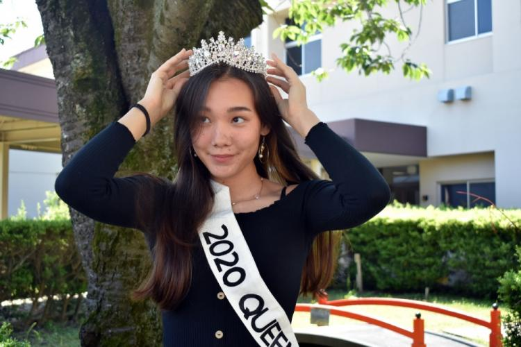 Leah Sakamoto-Flack, a senior at Zama Middle High School and this year's prom queen, puts on her tiara during a small ceremony for the prom court at the school on Camp Zama, Japan, May 29. To maintain social distancing, members of the prom court put on their own crowns.