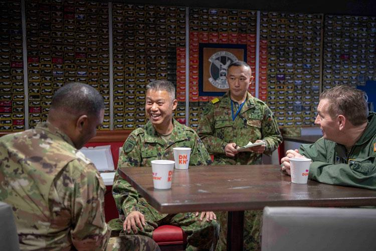 U.S. Air Force Col. Otis C. Jones, 374th Airlift Wing commander, left, Japan Ground Self-Defense Force Maj. Gen. Shigeo Kaida, 1st Airborne Brigade commander, center, and U.S. Air Force Col. Kevin Martin, 374th Operations Group commander, right, take a moment to talk before the jump safety brief at Yokota Air Base, Japan, Jan. 8, 2020. (U.S. Air Force photo by Airman 1st Class Brieana E. Bolfing)