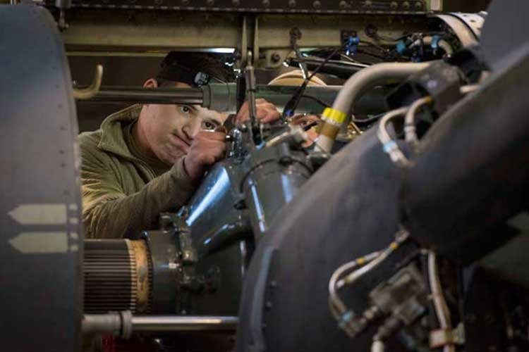 Airmen assigned to the 353rd Special Operations Group Detachment 1, perform maintenance on a CV-22 Osprey, January 15, 2019, at Yokota Air Base, Japan. During maintenance, the aircraft are taken apart so maintainers can perform preventive maintenance and identifying problems before they arise. (U.S. Air Force photo by Senior Airman Juan Torres)