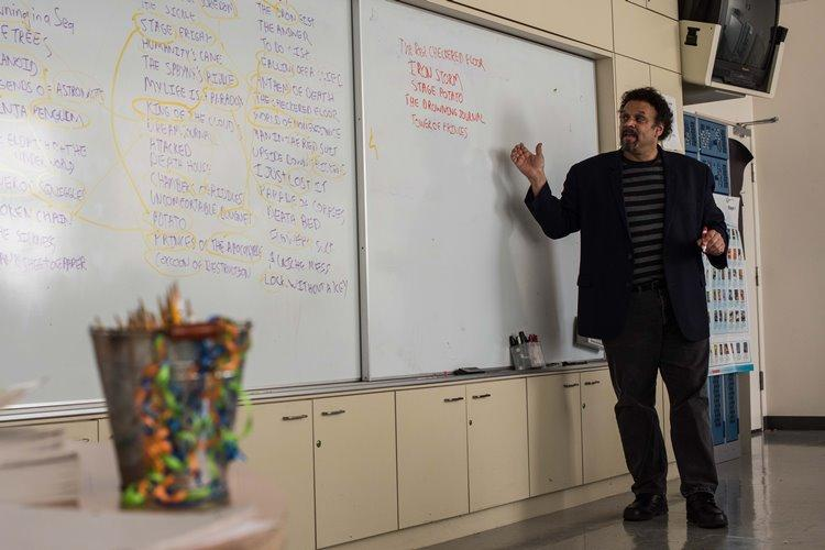 Neal Shusterman, a visiting author mixes up the student's suggested titles in a writing workshop to create uniquely creative titles for storytelling at Yokota Middle School, February 1, 2019. Shusterman has been a successful children's and young adult fiction writer for 34 years. (U.S. Air Force photo by Staff Sgt. Kyle Johnson)