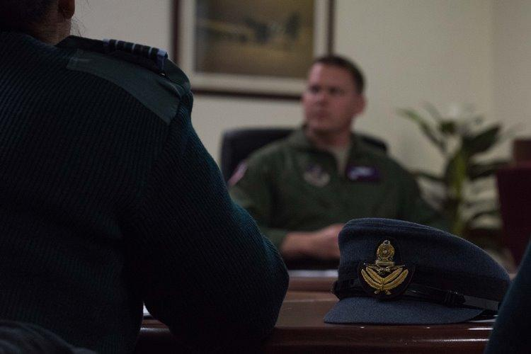 Sri Lanka Air Force members sit with U.S. Air Force members in a briefing highlighting USAF search and rescue operations at Yokota Air Base, Japan, Feb. 13, 2019. U.S. and Japanese officials shared lessons learned from a long heritage of collaboration on search and rescue operations.