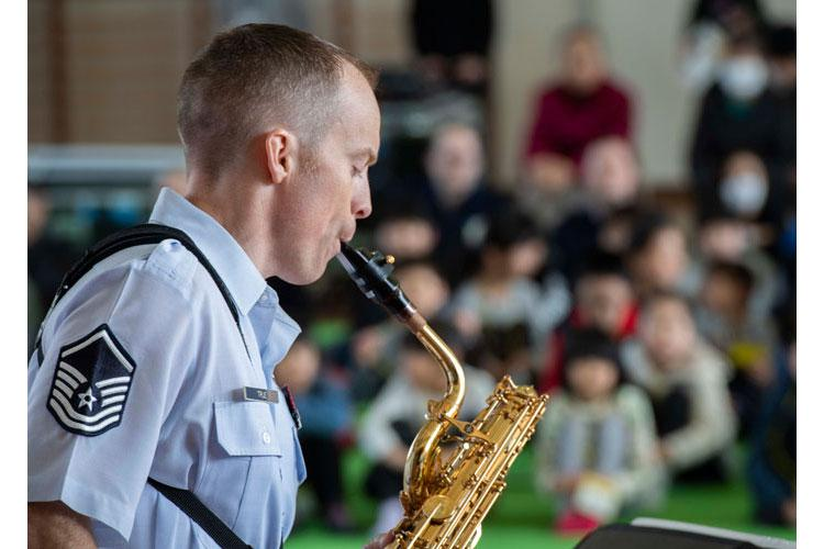 Master Sgt. Jeremiah True, U.S. Air Force Band of the Pacific saxophonist, performs for Shimazu Elementary School students, March. 8, 2019, at Kyotango City, Japan. The PACAF band performed several songs for the local community. (U.S. Air Force photo by Senior Airman Juan Torres)