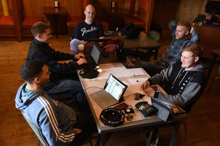 U.S. Airmen from the 35th Fighter Wing, Misawa Air Base, Japan, gather to play a tabletop role-playing game, March 7, 2020. The Toppers gaming club meets every Saturday at T's Burritos in the Enlisted Club. The club provided the opportunity for gaming enthusiasts to be a part of a community where Airmen share similar interests in tabletop games. (U.S. Air Force photo by Tech. Sgt. Chris Jacobs)