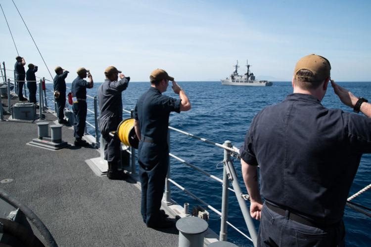 SOUTH CHINA SEA (March 21, 2019) Sailors aboard the Avenger class mine countermeasures ship USS Chief (MCM 14) render honors to Philippine Navy vessel BRP Ramon Alcaraz (FF 16) after completing a maritime cooperative activity. Chief, part of Mine Countermeasures Squadron 7, is operating in the Indo-Pacific region to enhance interoperability with partners and serve as a ready-response platform for contingency operations. (Photo by Petty Officer 2nd Class Jordan Crouch)