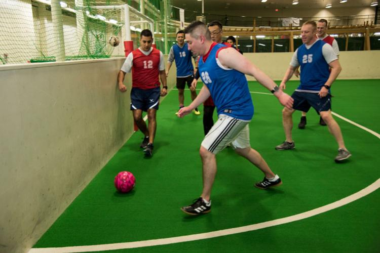 American and Japanese security forces members run for a ball in a bilateral soccer game at Misawa Air Base, Japan, March 15, 2019. This sporting event provided a way for both squadrons to connect and team build, which is crucial for the U.S.-Japan alliance. (U.S. Air Force photo by Branden Yamada)