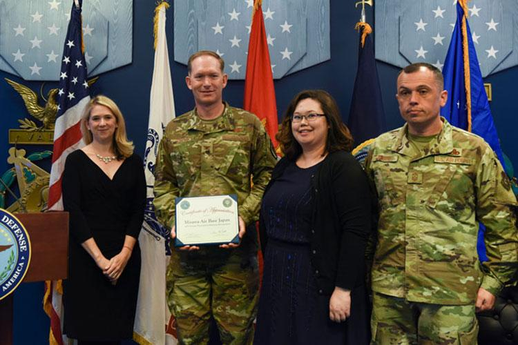 Col. Kristopher Struve, Misawa Air Base, Japan Wing commander, Command Chief Master Sgt. John C. Alsvig and Ms. Michelle Aldana accept a certificate of appreciation from Dr. Elizabeth P. Van Winkle, executive director, Office of Force Resiliency during the 2018 Defense Suicide Prevention Month recognition ceremony at the Pentagon, in Arlington, Va., May 15, 2019. Misawa AB was recognized by DoD two years in a row for suicide prevention outreach. (U.S. Air Force photo by Tech Sgt. Anthony Nelson Jr.)