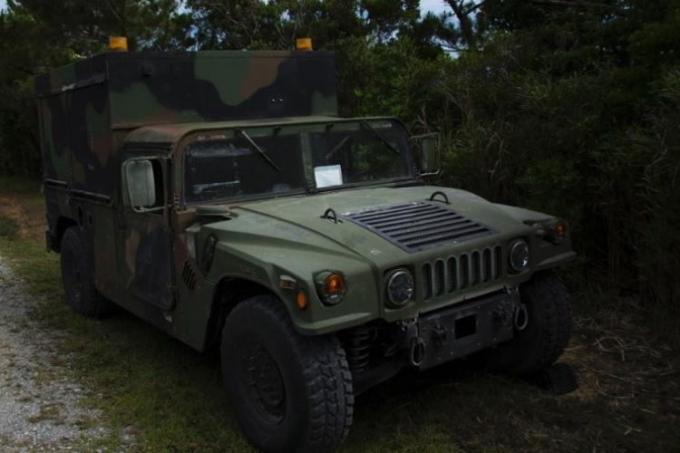 A Marine Corps Humvee is parked at the entrance of the Advanced Motor Vehicle Operations Course at Camp Schwab, Okinawa, May 23, 2019. (CARLOS VAZQUEZ/STARS AND STRIPES)