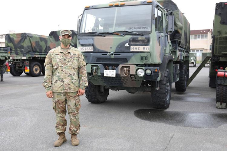 Sgt. Kalil Knight, a wheeled vehicle mechanic assigned to the 35th Combat Sustainment Support Battalion, poses for a photo May 20 at the Transportation Motor Pool on Camp Zama, Japan. (Photo Credit: Noriko Kudo)