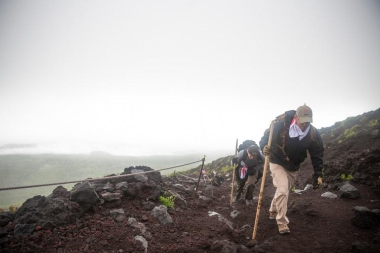 U.S. Marine Corps Col. Michael D. Rilley, right, commanding officer, Combined Arms Training Center (CATC) Camp Fuji, summits Mount Fuji alongside over 40 members of his command on July 19, 2019 in Shizuoka, Japan. CATC personnel hiked the mountain to enhance unit-wide morale and provide an opportunity for them to appreciate one of Japan's natural wonders. (U.S. Marine Corps photo by Sgt. Timothy)