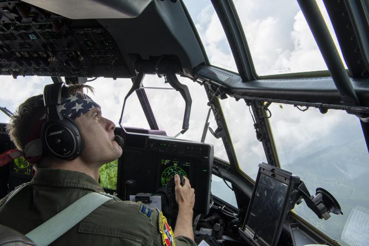 U.S. Air Force Capt. Michael Pyles, 36th Airlift Squadron C-130J pilot, performs a visual confirmation over Mount Aso, Japan, July 16, 2019, during flight training mission. The training allows USAF and JGSDF units to work alongside each other while improving the readiness of our armed forces. (U.S. Air Force photo by Yasuo Osakabe)