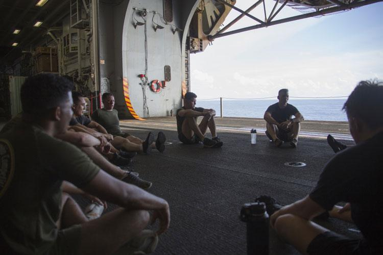 "PACIFIC OCEAN (Aug. 8, 2019) Marines and Sailors with the 31st Marine Expeditionary Unit have a guided discussion with Lt. Cmdr Jason Weatherwax, Chaplain with the 31st Marine Expeditionary Unit, after ""Chap's Fit"", a daily workout and discussion group focusing on spiritual toughness, aboard the amphibious assault ship USS Wasp (LHD 1). (Official U.S Navy photo by RP3 Anthony Wood-Casella)"