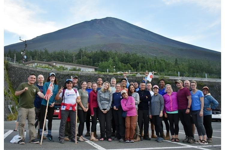 Tour guide Nobue Kobayashi, front, in pink top and brown pants, celebrates the fact that all 38 people on her Camp Zama Family and Morale, Welfare and Recreation tour of Mount Fuji made it to the top of the mountain Aug. 24. (Photo Credit: Courtesy photo)
