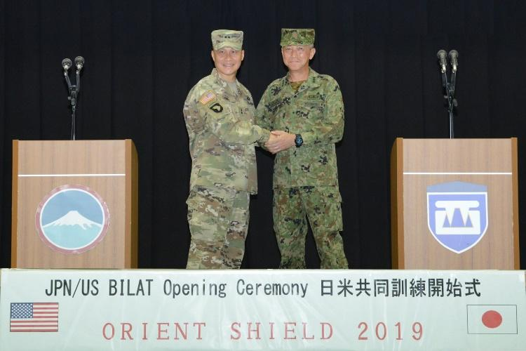 Commander of U.S. Army Japan, Maj. Gen. Viet Luong shook hands with the commander of the Western Army Japan Ground Self-Defense Force, Lt. Gen. Takashi Motomatsu during the Orient Shield 2019 opening ceremony. Orient Shield is an annual bilateral exercise designed to enhance Japan-U.S. combat readiness and interoperability while strengthening bilateral relationships and demonstrating U.S. resolve to support the security interests of friend and allies in the region. (Photo Credit: Courtesy)