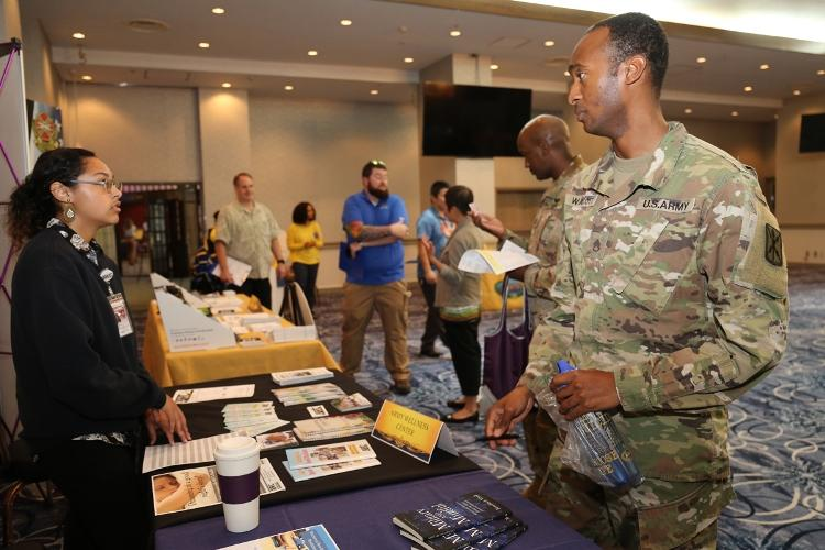 Staff Sgt. Donte Walcott, right, assigned to the 78th Signal Battalion, talks to an Army Wellness Center staff member during the Resilient Living Day training event Sept. 3 at the Camp Zama Community Club. The event was held as part of Suicide Prevention Awareness Month. (Photo Credit: Noriko Kudo, U.S. Army Garrison Japan Public Affairs)