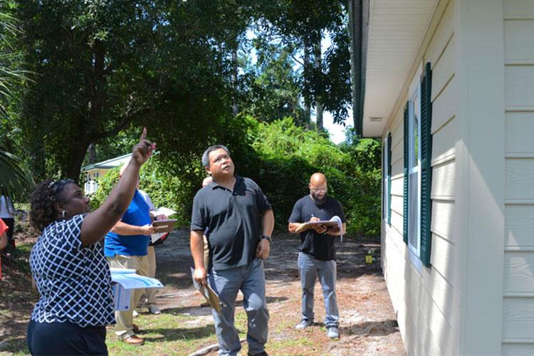 JACKSONVILLE, Florida (Sept. 26, 2019) Student inspectors examine the exterior of a cottage for structural damage or deficiencies as part of their Certified Navy Housing Inspector Level 1 certification at Naval Air Station (NAS) Jacksonville, Sept. 26, 2019. (US Navy photo by Mass Communication Specialist 2nd Class Nick A. Grim/Released)