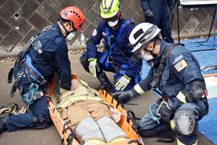 U.S. military firefighters use a dummy to demonstrate how they would help a medical casualty during a demonstration of hands-on rescue training at Camp Zama, Japan, March 28, 2019. The training was a part of the 33rd annual U.S. Forces Japan Fire Officers Association Training Symposium.