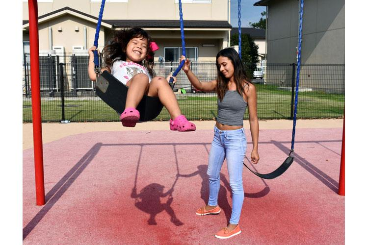 Andrea Muniz, 3, swings at a playground at Sagamihara Family Housing Area, Japan, with her mother, Keyla Rodriguez, Sept. 30. (Photo Credit: Wendy Brown, U.S. Army Garrison Japan Public Affairs)