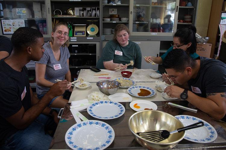 U.S. Marines and families from Marine Corps Air Station Iwakuni participate in a community cultural exchange with local Japanese children at Tsuzu Elementary School, Iwakuni City, Japan, Aug. 29, 2019. The exchange provided an arts and crafts class as well as a cooking class. Participants learned how to make gyoza and residents were given an opportunity to experience Japanese culture. (U.S. Marine Corps photo by Lance Cpl. Triton Lai)