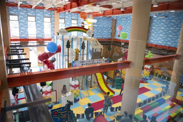 Japanese and American guests gather in the recreational play zone for the grand opening of the Misawa Kids Center SORAIE in Misawa City, Japan, April 9, 2019. The play zone is one of many rooms offered in the facility and is open from 8:30 a.m.-10:00 a.m., 10:30 a.m.-12:00 p.m., 1:00 p.m.-2:30 p.m. and 3:00 p.m.-4:30 p.m. Monday-Sunday, excluding Tuesday. (U.S. Air Force photo by Staff Sgt. Brittany A. Chase)