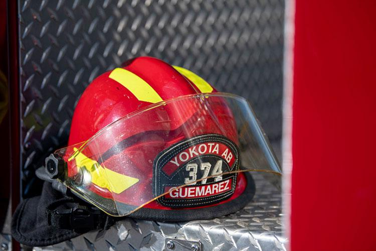 A 374th Civil Engineer Squadron firefighter helmet sits on a fire truck at Yokota Air Base, Japan, May 7, 2020. All firefighters have their names written on the helmet to help identify them while in their gear. (U.S. Air Force Photo by Airman 1st Class Brieana E. Bolfing)