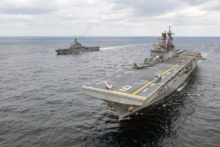 The amphibious assault ship USS America and the Japan Maritime Self-Defense Force amphibious transport dock ship JS Kunisaki steamed together in the East China Sea on Jan. 13, 2020. VINCENT E. ZLINE/U.S. NAVY
