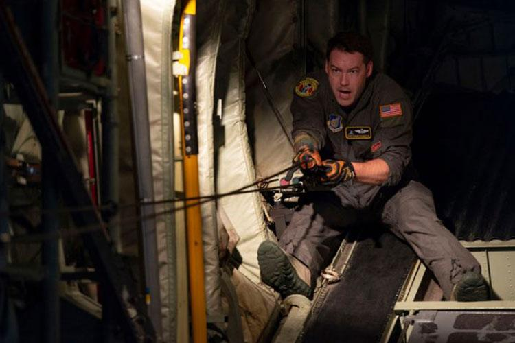 Tech. Sgt. Barney Barnette, 36th Airlift Squadron loadmaster, prepares a static line on a C-130J Super Hercules at Yokota Air Base, Japan, July 8, 2020. Loadmasters ensure aircraft configurations are correct and properly prepared for paratroopers to jump, as well as handle any emergency procedure that may occur during drop operations. (U.S. Air Force photo by Staff Sgt. Gabrielle Spalding)