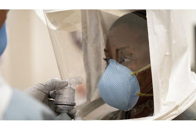 Lt. Tiffany Bradley participates in fit testing for an N95 respirator and survival mask at Naval Hospital Okinawa, Okinawa, Japan March 27, 2020. The wearing of protective gear while battling the COVID-19 pandemic can cause adverse reactions in health care workers. (U.S. Marine Corps photo by 1st Lt. Tori Sharpe)