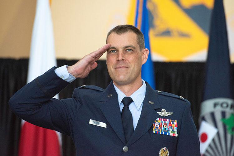 Col. Andrew J. Campbell, 374th Airlift Wing incoming commander, salutes after his name was unveiled on the wing's flagship C-130J Super Hercules during an assumption of command ceremony at Yokota Air Base, Japan, June 22, 2020. Having previously served as the 36th Airlift Squadron commander, Col. Campbell is accompanied by his wife Katie and their son, Ford, this assignment marks the third time the Campbell family will be stationed at Yokota. (U.S. Air Force photo by Machiko Arita)